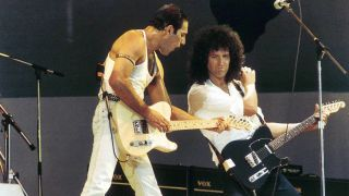 Queen live on stage at Wembley Stadium