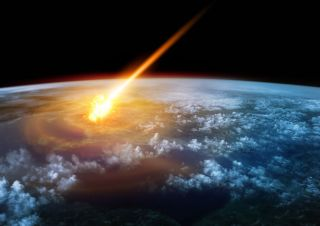 Glowing meteor, fireball entering Earth's atmosphere.