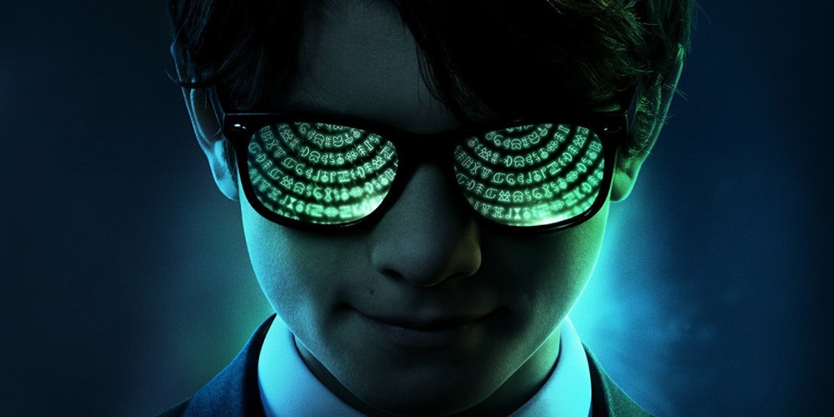 Artemis Fowl wearing glasses reflecting a code