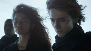 Zendaya and Timothée Chalamet looking down with blue eyes in Dune.