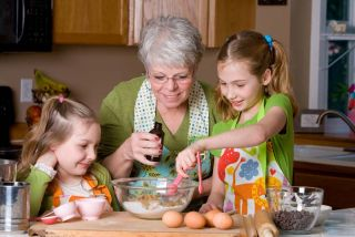 Grandma baking with grandkids.