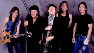 A picture of Phil Rudd with AC/DC in 2001