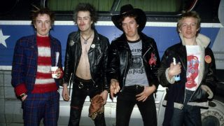 Sex Pistols, group portrait in front of bus during their final tour