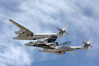 Virgin Galactic's second SpaceShipTwo, the VSS Unity, is carried by its WhiteKnightTwo mothership ahead of Unity's third unpowered glide test over the Mojave Air and Space Port in California on Feb. 24, 2017.