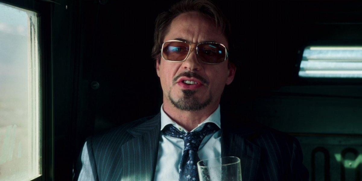 Iron Man Robert Downey Jr in a humvee, drinking