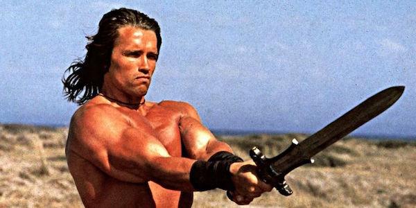 Arnold Schwarzenegger's Conan holding out sword