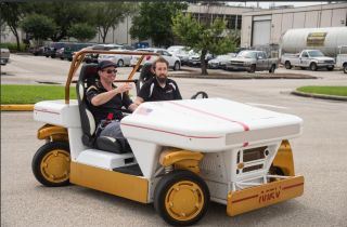Author Andy Weir (left) takes a ride on NASA's Modular Robotic Vehicle at the Johnson Space Center in Houston during Mars Week in April 2015.