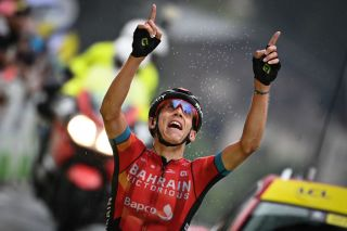Dylan Teuns of Bahrain Victorious celebrates as he crosses the finish line to win stage 8 of the 108th edition of the Tour de France