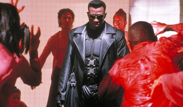 Blade surrounded by club vampires drenched in blood