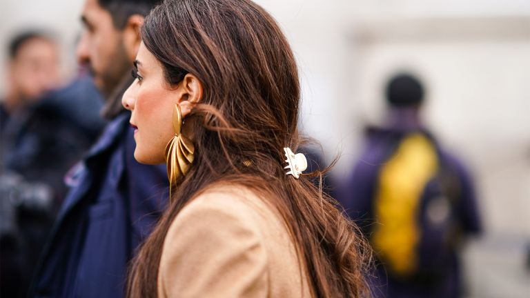 PARIS, FRANCE - FEBRUARY 29: A guest wears golden earrings, outside Elie Saab, during Paris Fashion Week - Womenswear Fall/Winter 2020/2021, on February 29, 2020 in Paris, France. (Photo by Edward Berthelot/Getty Images)