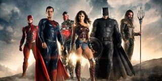 The Flash, Superman, Cyborg, Wonder Woman, Batman and Aquaman stand on a mountain in a promotional i