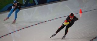 Speed skaters competing, sochi 2014