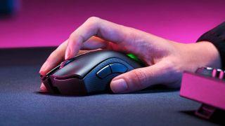 Person holding Razer DeathAdder V2 Pro mouse