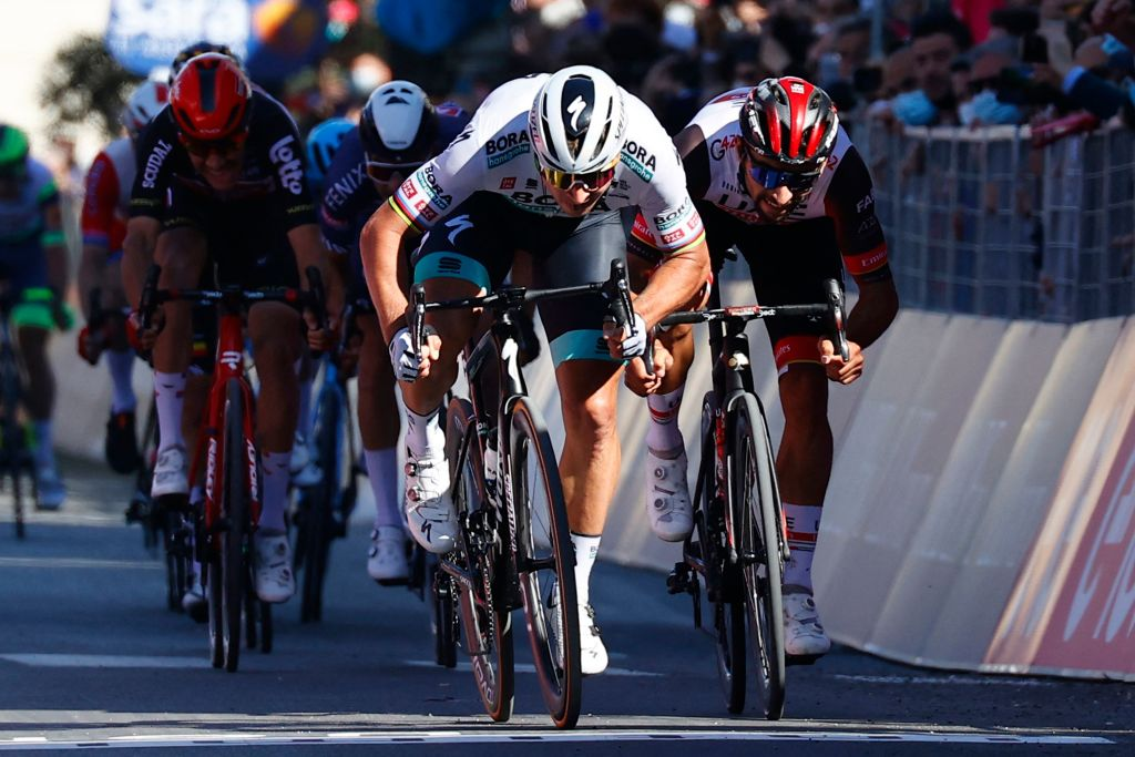 Team BoraHansgrohe rider Slovakias Peter Sagan sprints to cross the finish line to win the tenth stage of the Giro dItalia 2021 cycling race 139 km between lAquila and Foligno on May 17 2021 Photo by Luca Bettini AFP Photo by LUCA BETTINIAFP via Getty Images