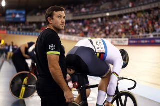 The Australian Cycling Team's sprint coach, Ross Edgar, helps the then world champion, Matthew Glaetzer, prepare for the sprint at the London round of the 2018 UCI Track World Cup