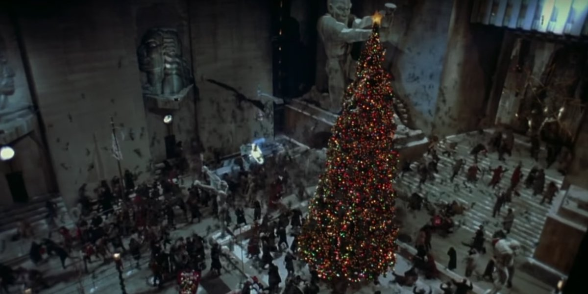 Batman (Michael Keaton) soars around the Gotham City Christmas tree in Batman Returns