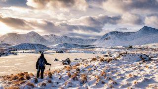 A lone walker in scotland's winter mountains
