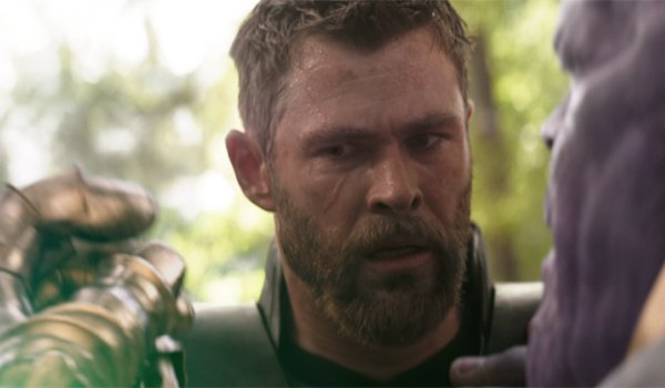 Thor watches Thanos snap his fingers in Avengers: Infinity War
