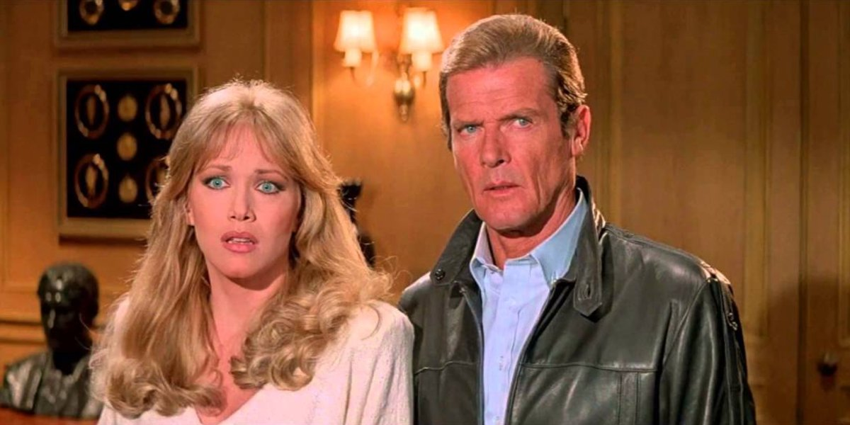 A View To A Kill Tanya Roberts and Roger Moore looking confused in an office