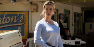Betty Gilpin poses in a scene from The Hunt.