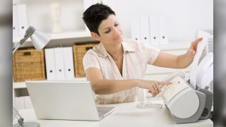 Woman sending fax