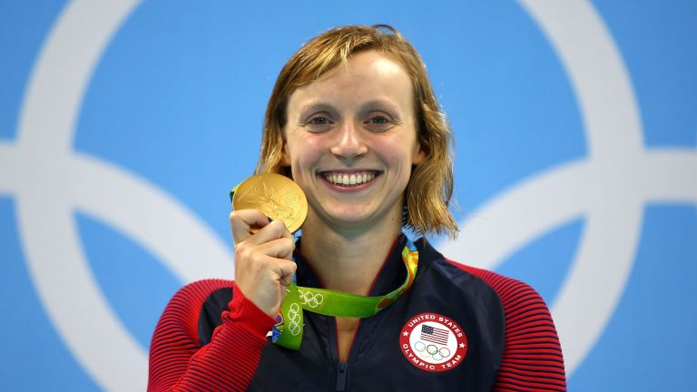 Katie Ledecky of United States celebrates on the podium after winning gold in the Women's 800m Freestyle Final on Day 7 of the Rio 2016 Olympic Games