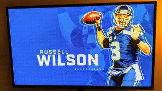 Russell Wilson on screen with graphics on TV