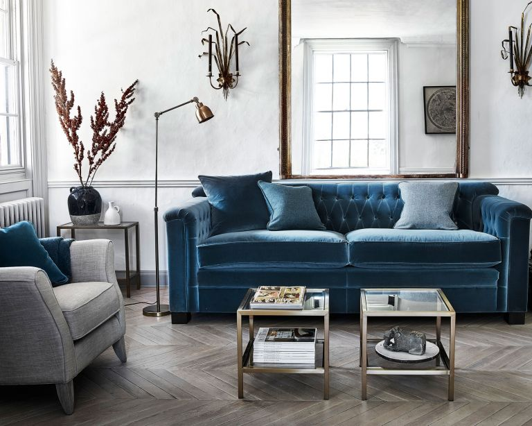 living room with blue velvet sofa