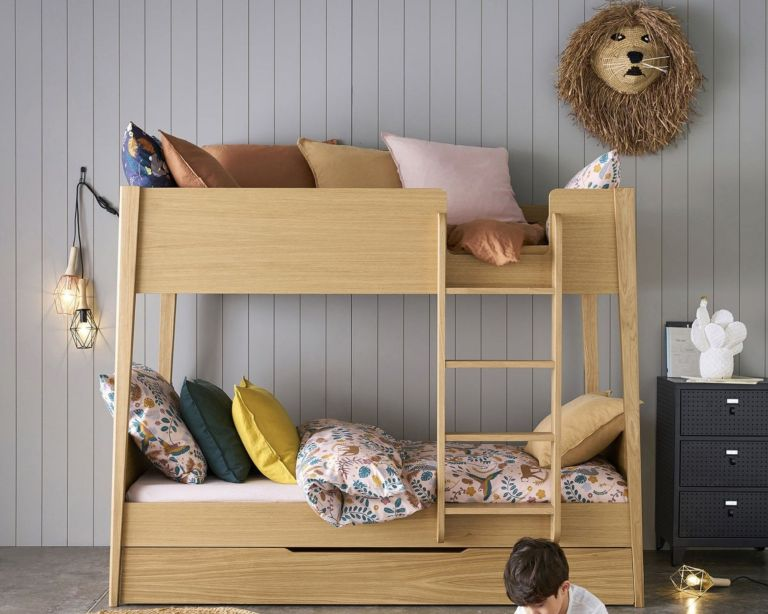 La Redoute Alceste Oak Bunk Bed in kids room, with colourful cushions and grey panelled wall