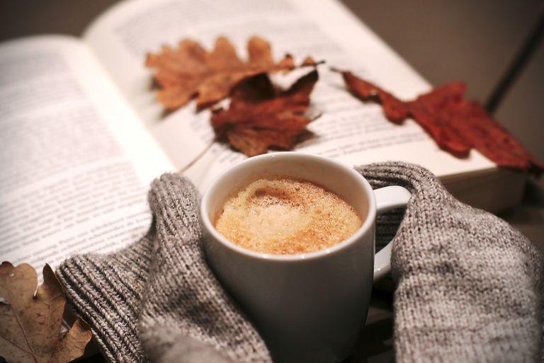 coffee mug with cozy home decor