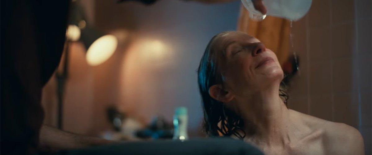 Arthur giving his mother Penny a bath
