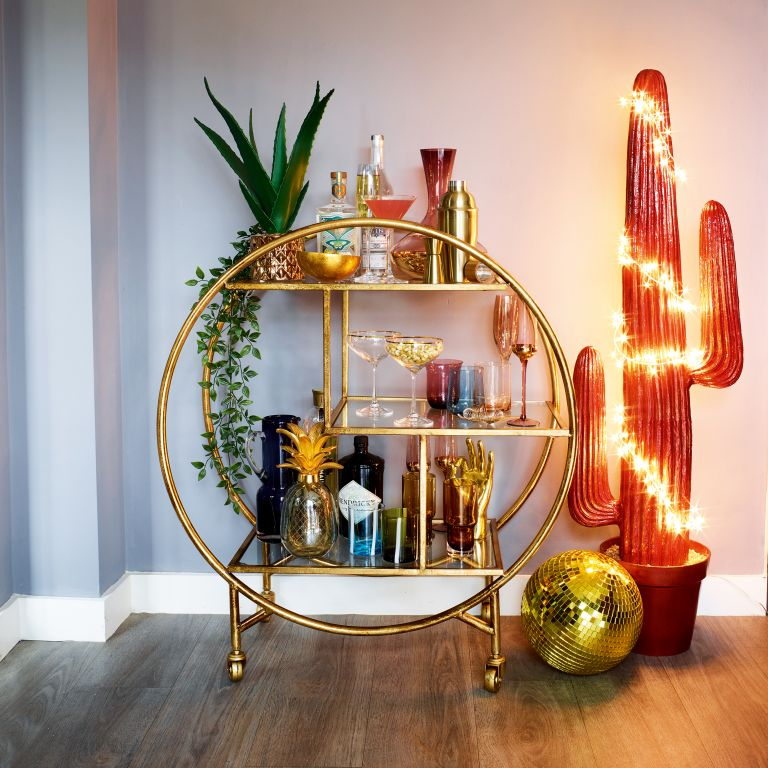 Bar carts: Audenza bar cart with gin and glasses on it