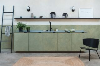 Replacing kitchen doors on a basic carcass has created a design statement in this space