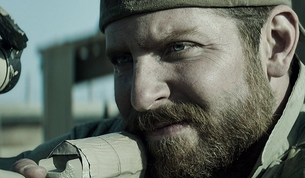American Sniper Bradley Cooper Chris Kyle aiming his scope at a target
