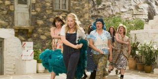 Donna (Meryl Streep) and her friends sing and dance in the streets in Mamma Mia!