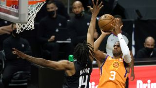 Chris Paul #3 of the Phoenix Suns goes up for a shot against Terance Mann #14 of the LA Clippers during the first half in Game Six of the Western Conference Finals at Staples Center on June 30, 2021 in Los Angeles, California.