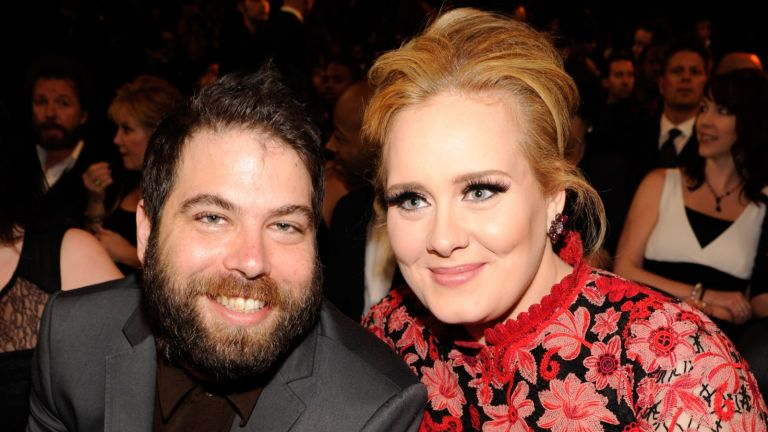 Adele has finalized her divorce, Adele (R) and Simon Konecki attend the 55th Annual GRAMMY Awards at STAPLES Center on February 10, 2013 in Los Angeles, California.
