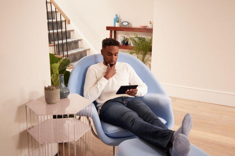 Kobo Libra 2 being read on sofa
