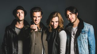 The band Halestorm standing in a line