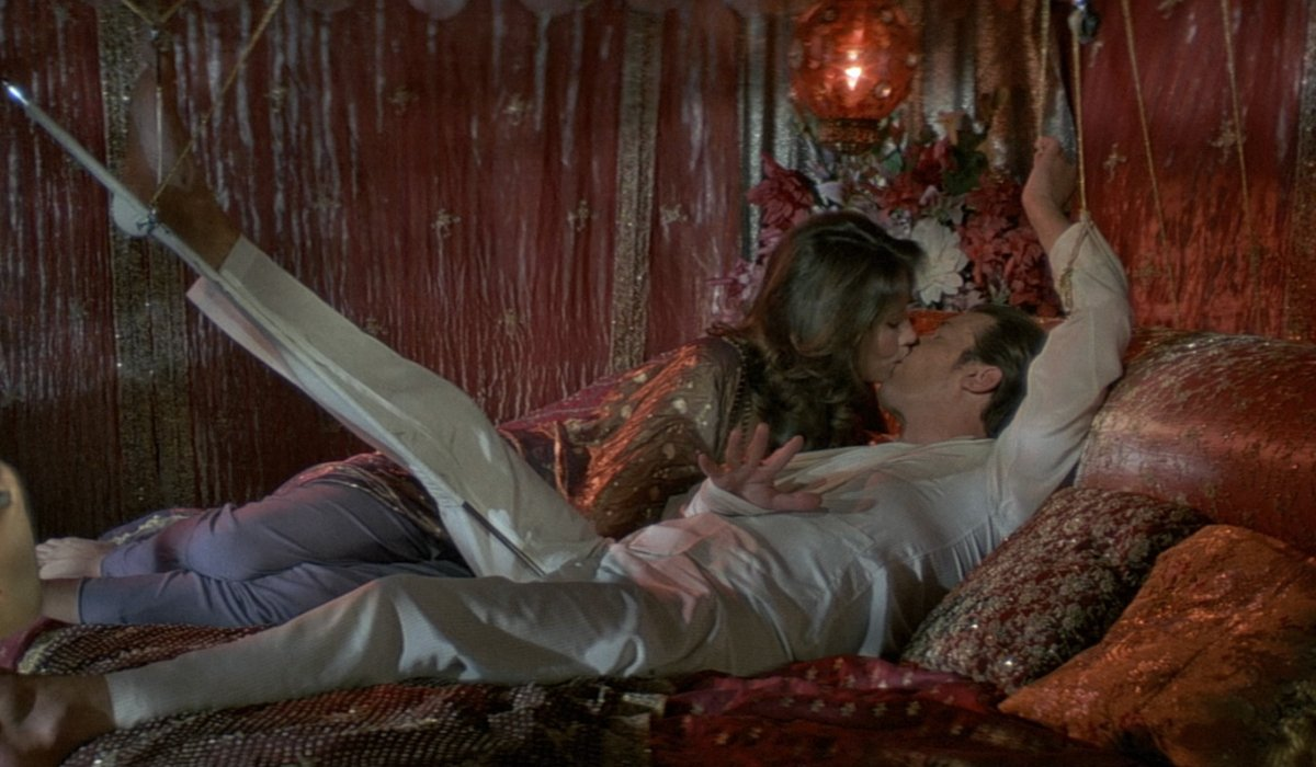 Maud Adams and an injured Roger Moore kissing in the finale of Octopussy.