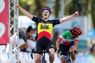 Lotte Kopecky of Belgium and Team Liv Racing celebrates winning ahead of Elisa Longo Borghini of Italy and Team Trek Segafredo during the 7th Ceratizit Challenge By La Vuelta 2021 Stage 4