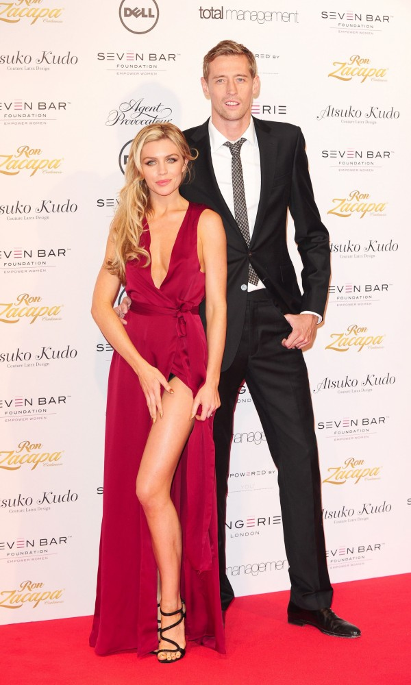 A picture of Peter Crouch and Abbey Clancy at a fashion show