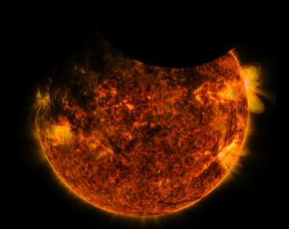 NASA's Solar Dynamics Observatory witnesses the moon and the Earth passing across the face of the sun simultaneously on Sept. 1, 2016.