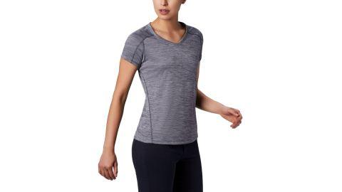 A woman wearing a grey running top