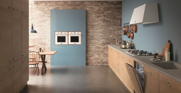 copper and white oven in blue wall in country kitchen