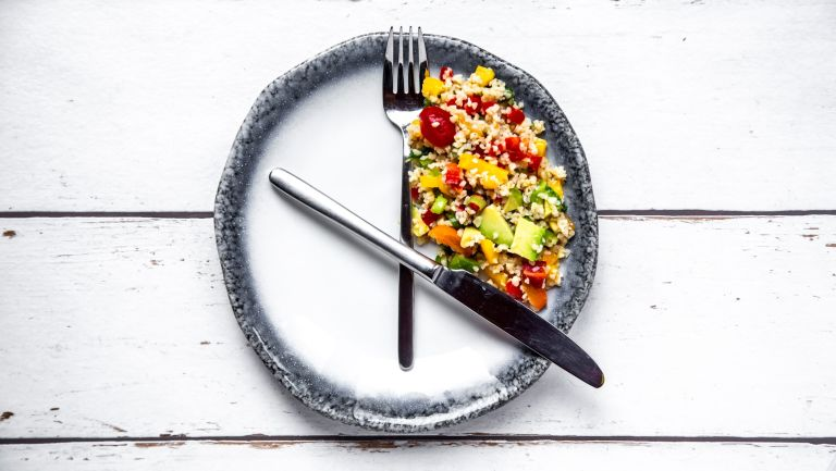 The 5:2 diet: a watch on a plate demonstrates intermittent fasting
