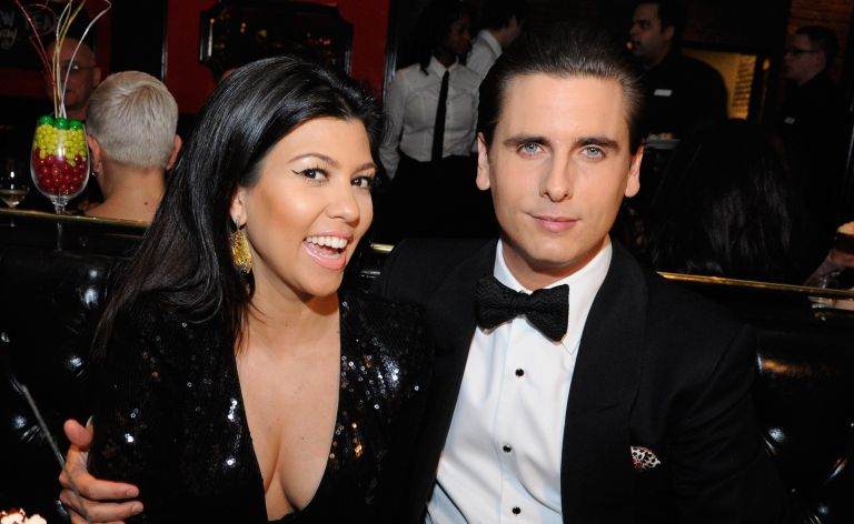 Television personalities Kourtney Kardashian (L) and Scott Disick celebrate New Year's Eve at the Sugar Factory American Brasserie