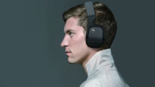 the side profile of a man wearing the yamaha yh-l700a wireless headphones
