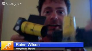 Rainn Wilson Holds ARKYD Telescope Model