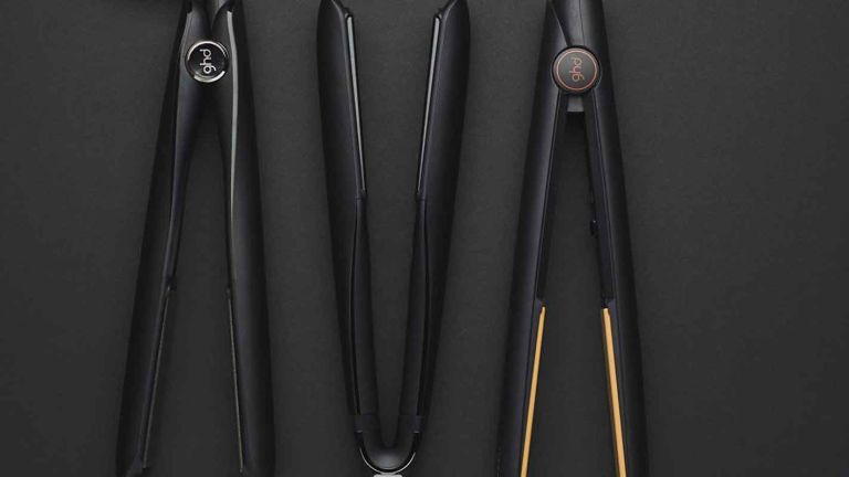 GHD sale: GHD hair straighteners in line on black background